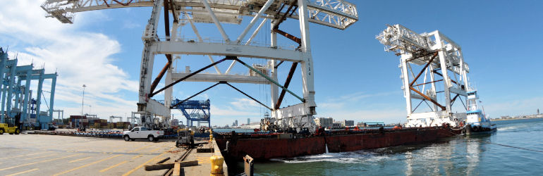 First crane being offloaded from barge