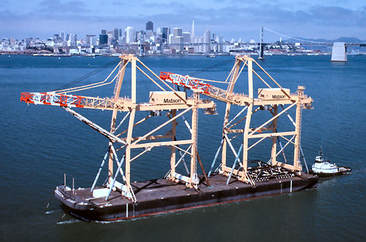 Barge departing with 2 container cranes on deck