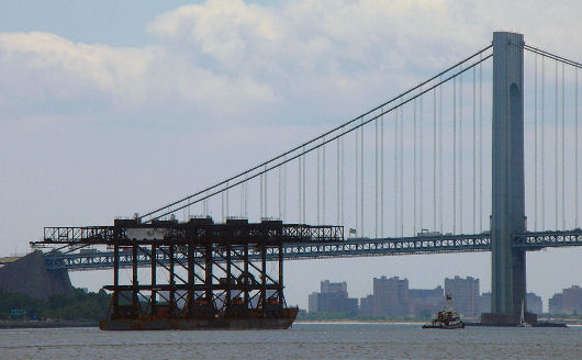 Barge loaded with cranes departs from Newark